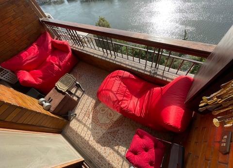 In zamalek Sunny & Stylish Direct Overlooking Nile