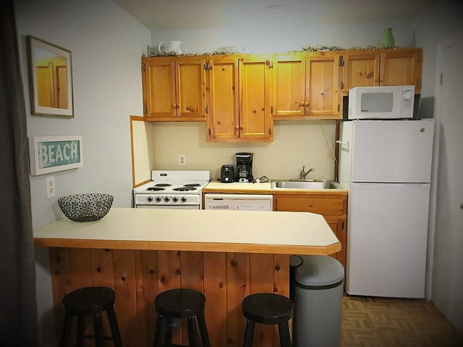 Full kitchen with stove, oven, dishwasher, refrigerator, toaster, coffee pot, microwave and fully stocked with dishes/utensils.
