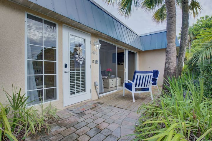 Front entry into this beautiful two bedroom condo.  Sliders open to the patio that lies under shaded palm trees.
