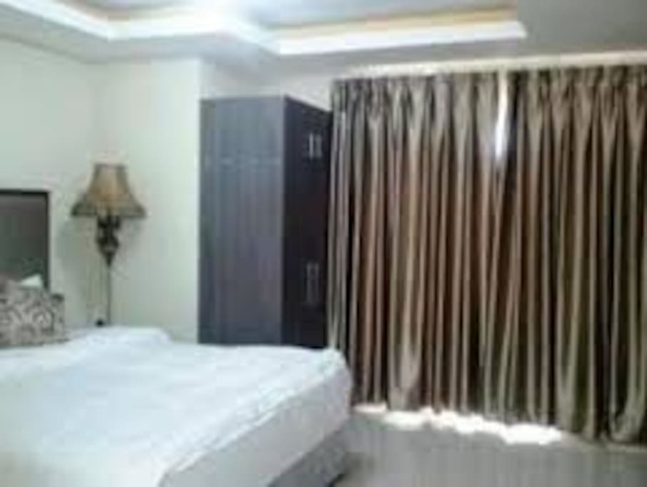 huge bed with balcony with views over manila bay