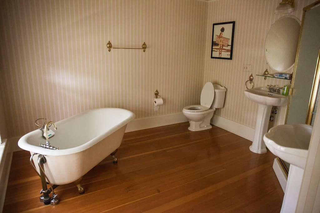 Large Bathroom with old fashioned tub and corner full shower