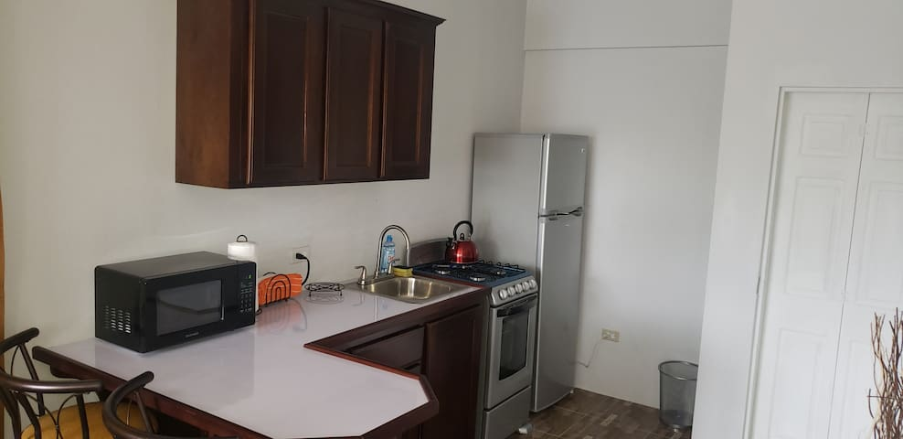 Newly rennovated kitchen equipped with utensils,  pots, plates etc. Feel free to prepare your own meals or just swing by a nearby restaurant in the Liguanea area