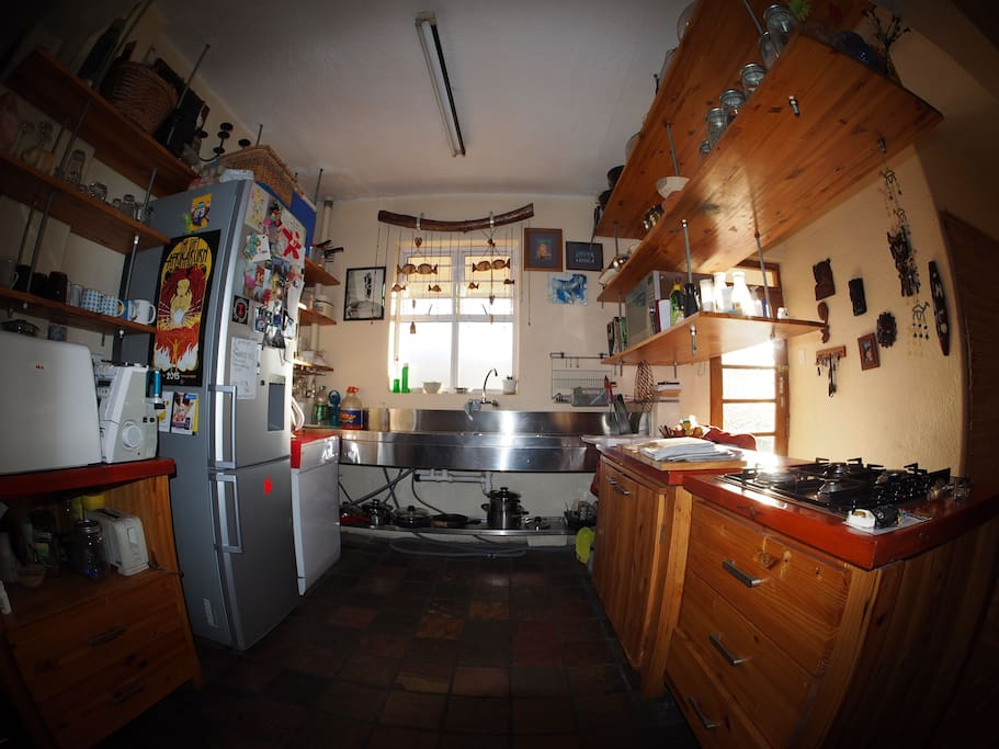 Fully equiped kitchen with fridge, stove and convection microwave.