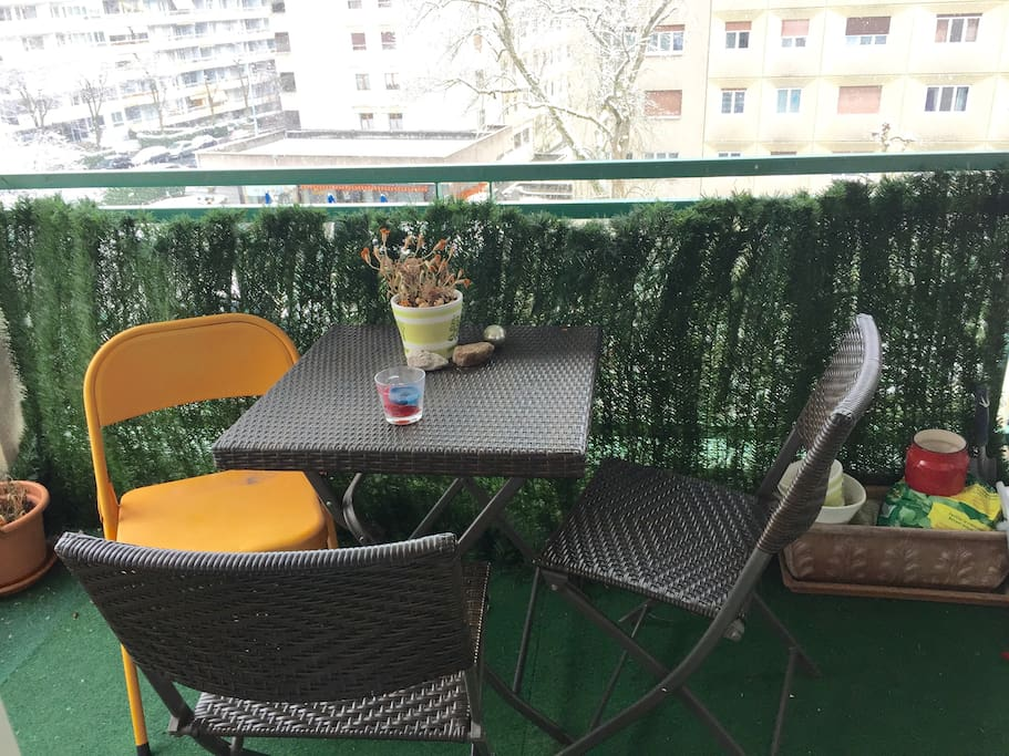 A small table outside for sunny days