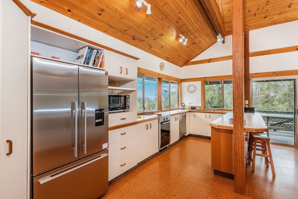 Open plan kitchen with high ceilings