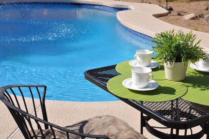 Pool area, furniture table and 4 chairs.