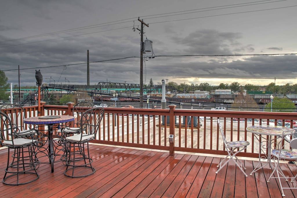 Keep cool on this spacious outdoor deck overlooking the historic downtown and rail road tracks.