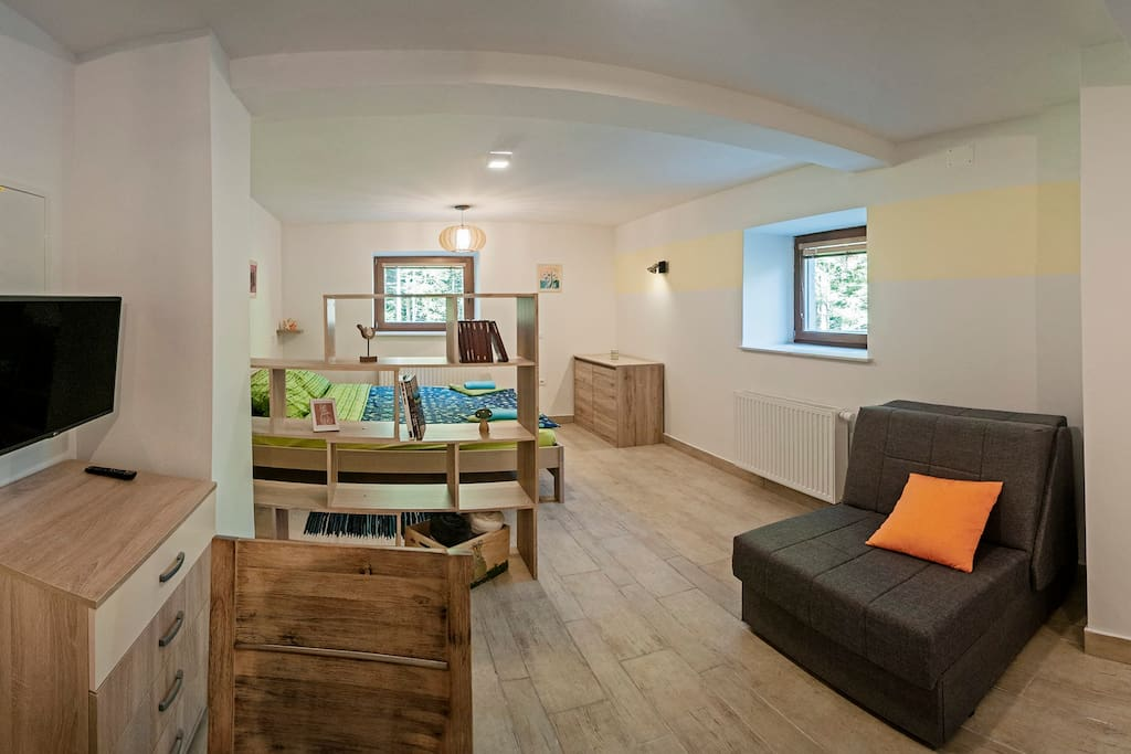 This is studio apartment with double bed, small kitchen and separated bathroom