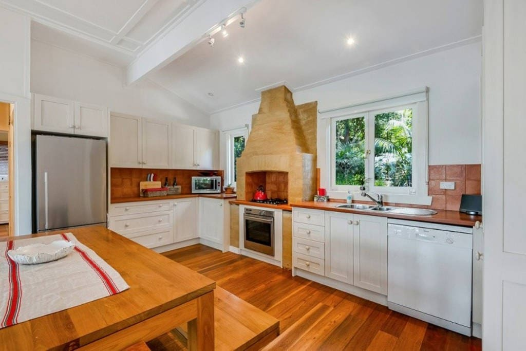 The entertainers delight eat-in kitchen featuring Timber & Stainless Steel