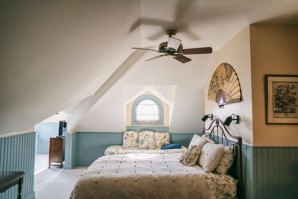 Tilghman Island Room - Bedroom with Daybed under Victorian Dormer Window & Entrance to Turret Sitting Room