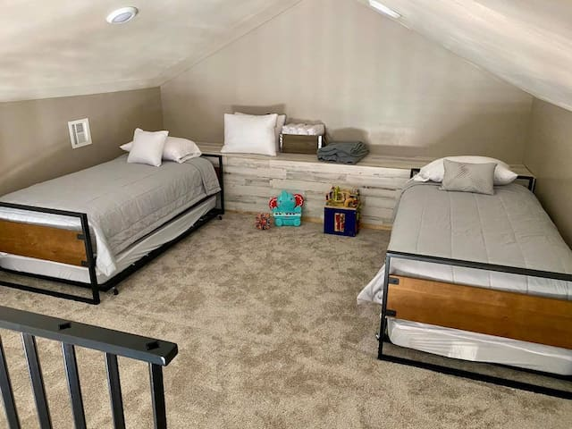 Loft-twin beds with pull out trundles (4 beds total)