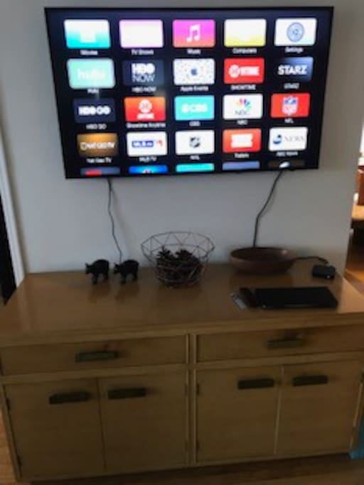 """In our living room we have 50"""" tv that can be used to surf, apple tv, hulu and netflix. Listen to music. The keyboard works too!"""