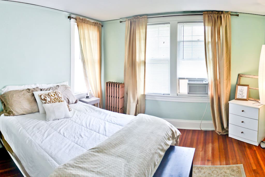 Guest room with extra pillows, blankets & bathroom towels. AC unit for summer stays.