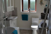 Recently installed upstairs bathroom with WC, bath / power shower. Toiletries / shower mat and towels provided.