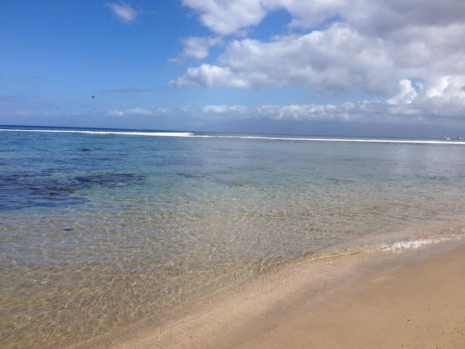 2 minute walk to Baby beach awaits you across the street from our place.  A well sheltered from the reef so it's shallow and calm waters.  Absolute paradise.  You can see the island of Lanai and Molokai as you stroll down this sand bottom beach.