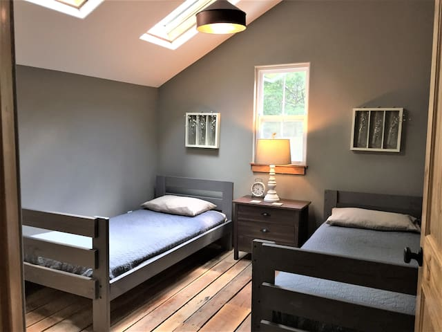 Upstairs Bedroom with twin beds and skylights