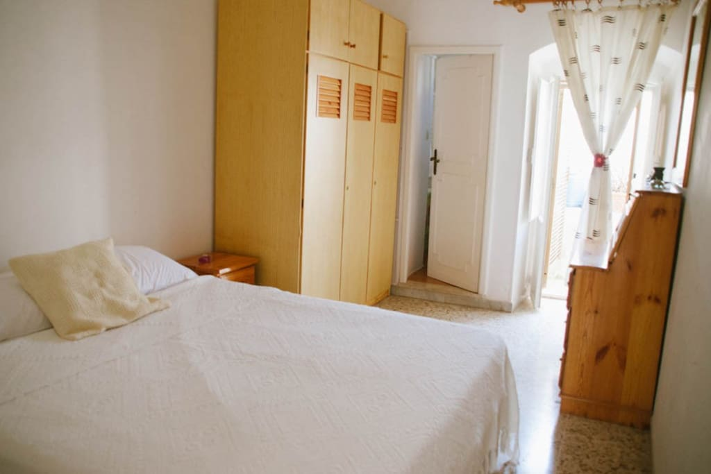 Large double bedroom with small terrace and en-suite bathroom