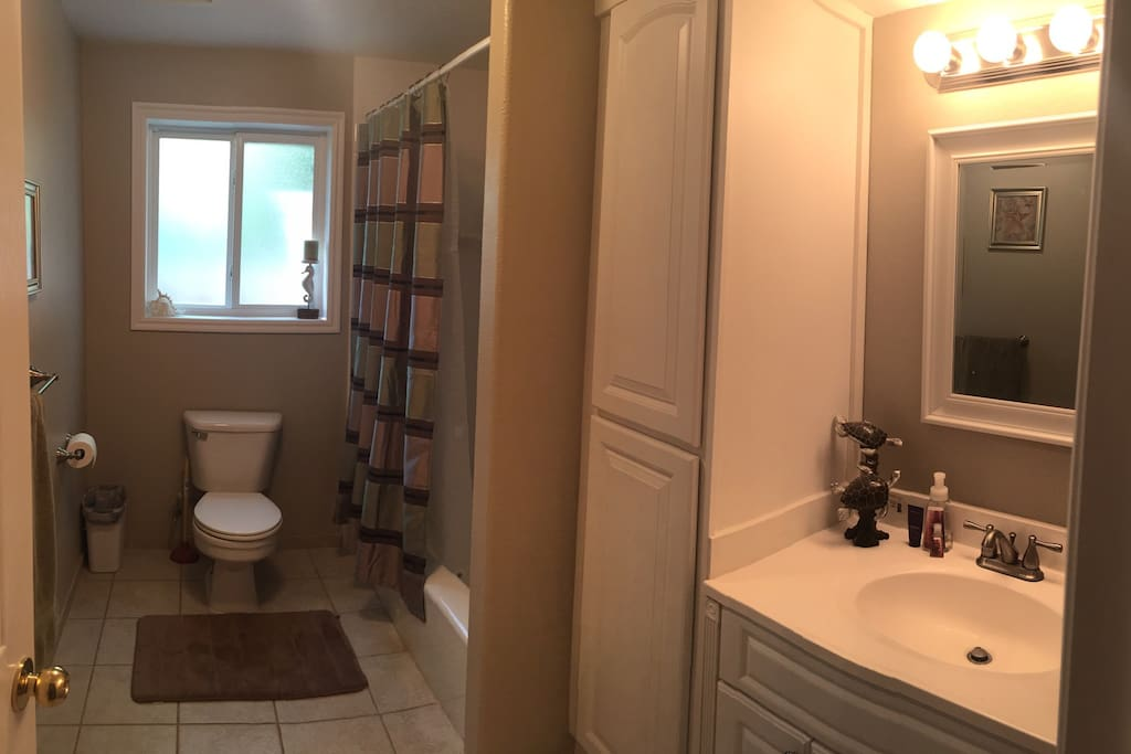 Private full bath with tub/shower combo located next to private bedroom