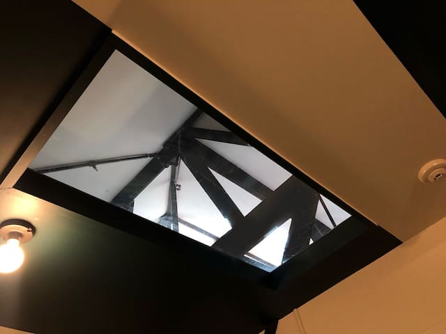 This third floor windowless room features a gorgeous skylight with a remote control shade to let in lots of natural light!