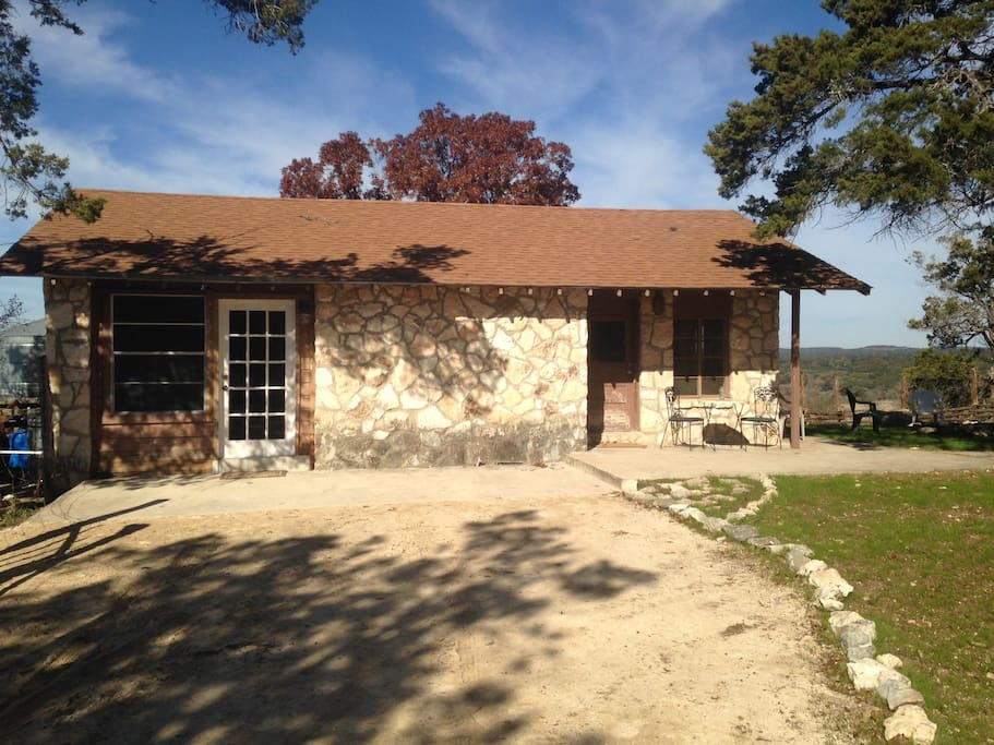 Classic hill country cabin perched on a cliff over the Guadalupe River.