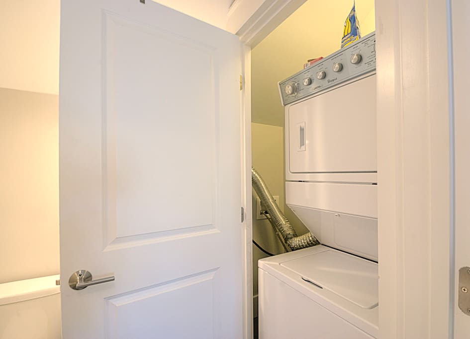 The stacked washer and dryer are accessed thru the bathroom. A great amenity for your stay, no matter how long!