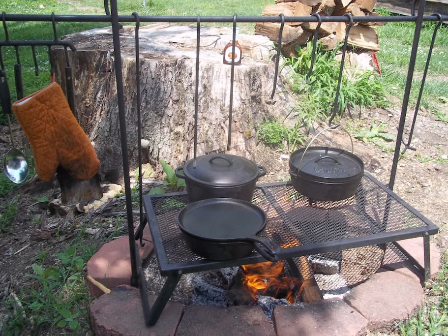 Our backyard Cookout Setup so you can see how to use your campsite. Hooks are for temperature control. Chicken Foot on right for lifting lids. Bring your iron skillets & Dutch Oven!