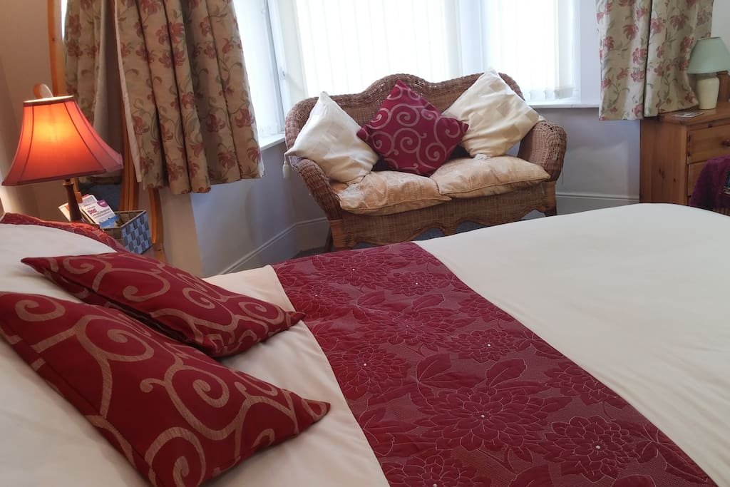 It's a very cosy and spacious room with a comfortable double bed and a single bed, chairs & table.