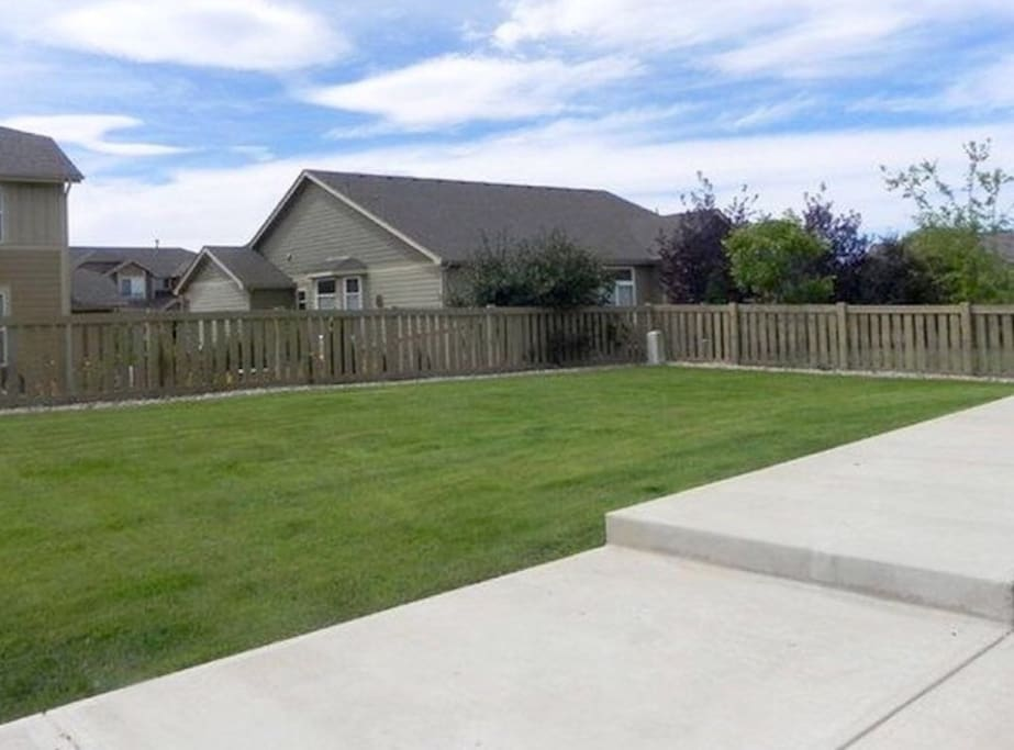 We added a 15' enclosed trampoline to the right side of the yard. (Use at your own risk)