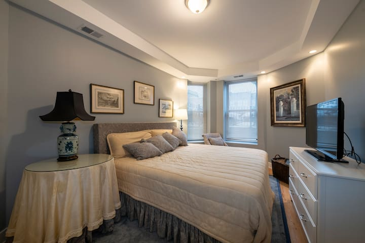This is the primary bedroom.  It has a king size bed, a slipper chair with reading light next to the bed, a generous dresser, large TV, apple TV and cable box.  There is also a walk-in closet. The mattress is a Simmons Beauty Rest Platinum Elite