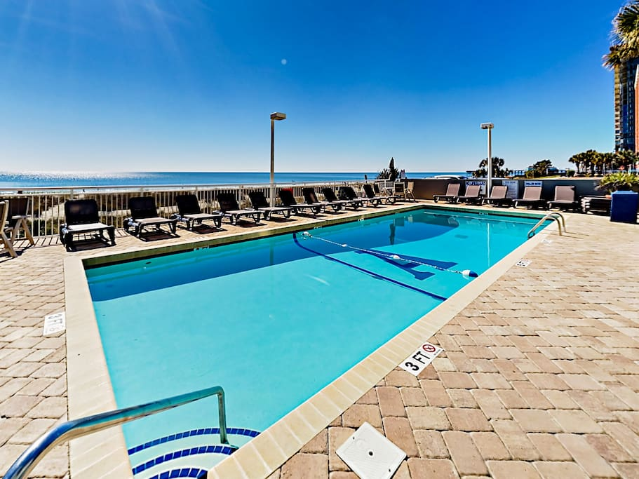 Watch the ocean waves from the Atlantica community pool.