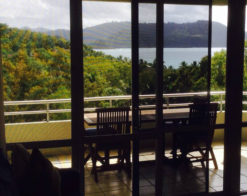Large balcony with BBQ overlooking Cats Eye Bay.