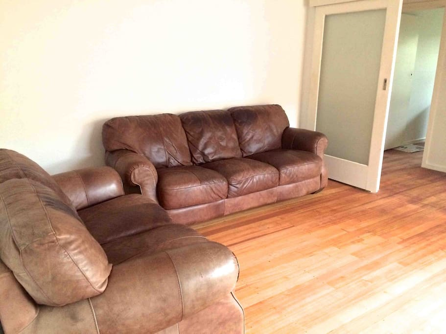 sunny lounge room with comfortable leather couch