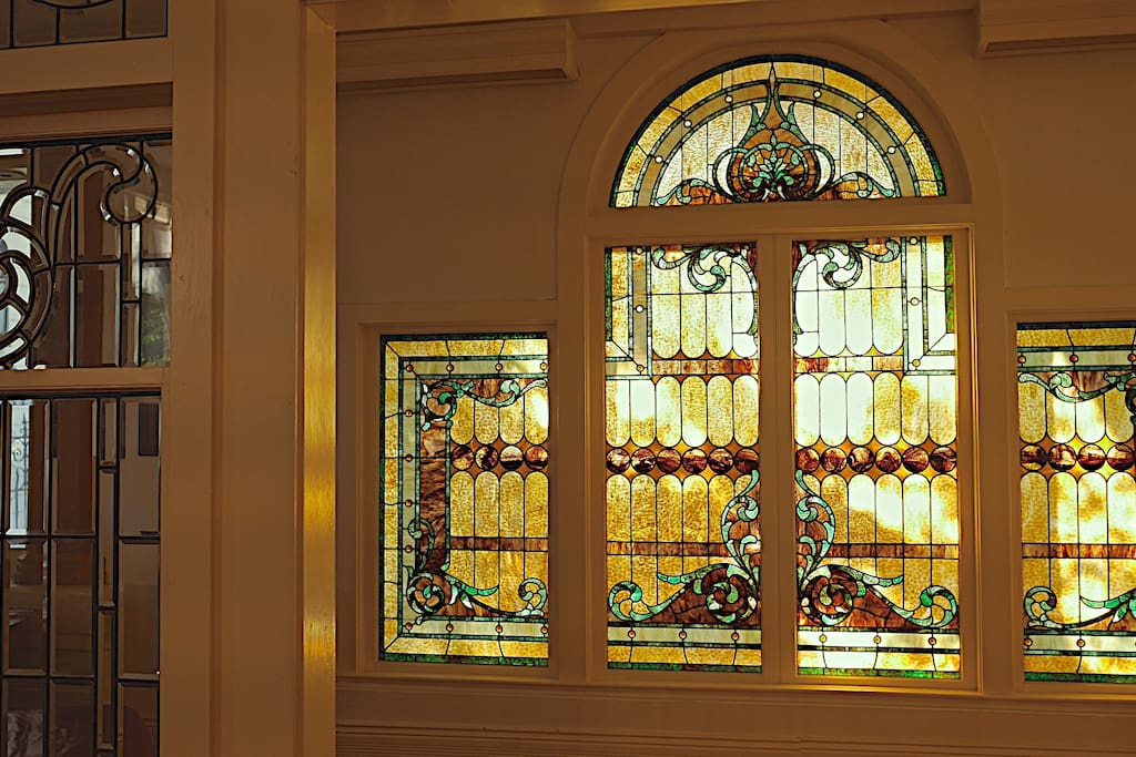 Stained and leaded glass greet you when you walk in.