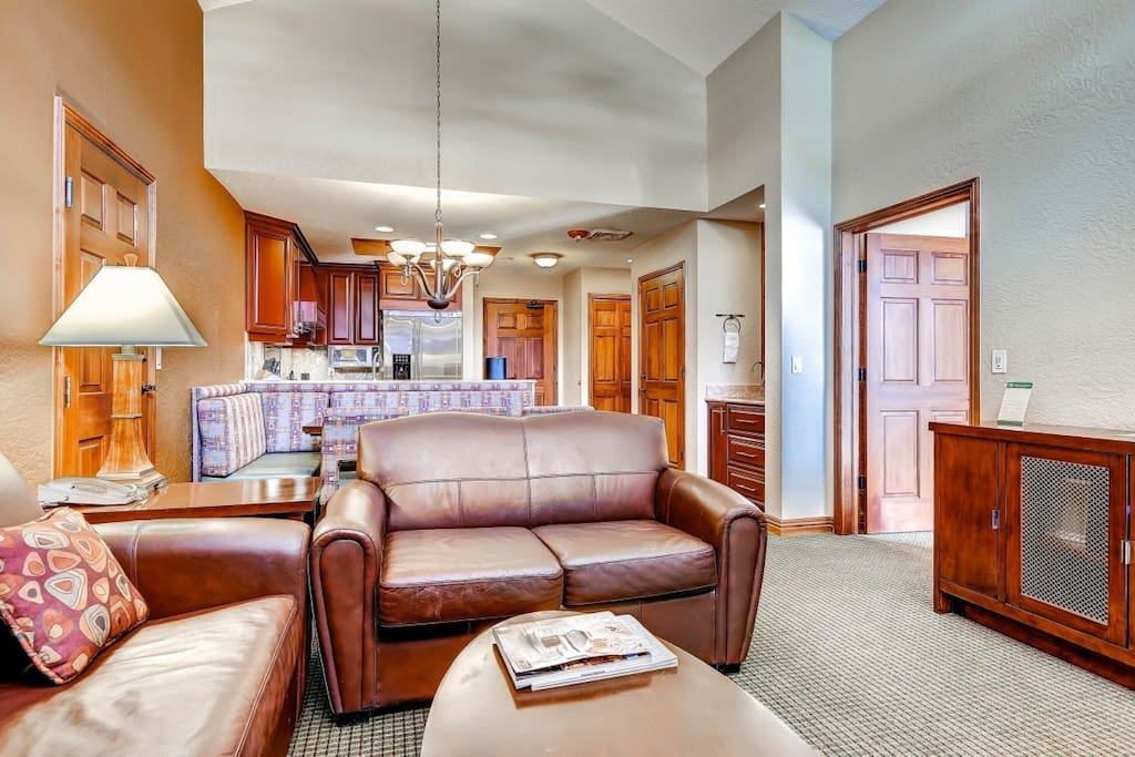 The condo features floor to ceiling windows, vaulted ceilings and all the comforts of home.