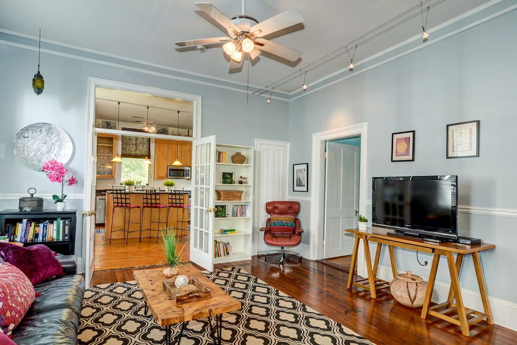 This spacious home (very rare for Charleston to have this much sq. footage) has an open floor plan throughout, so you and the other guest can relax in comfort without being cramped! Here is your living room with an Eames Chair and Direct TV!