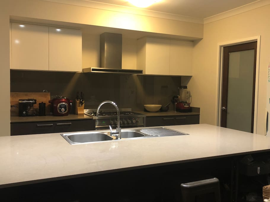 Large kitchen with walk in pantry, large stainless steel oven and cook top with wok burner. Dishwasher are appliances. Just feel at home! - Note: there is no microwave oven.