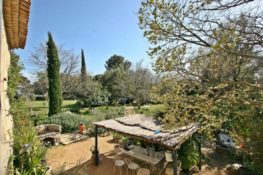 The view over the garden from the Master's bedroom, with the barbecue for some memorable grilling moments!