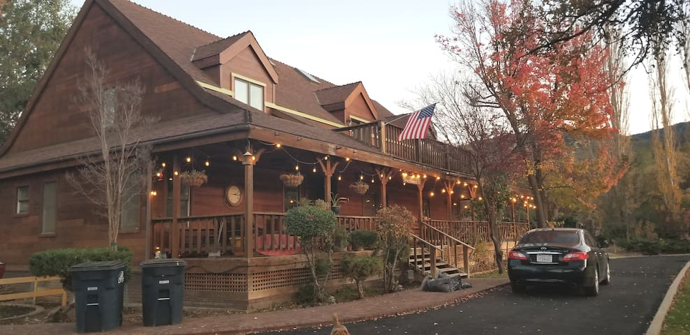 Front of home in twilight. Porch faces East