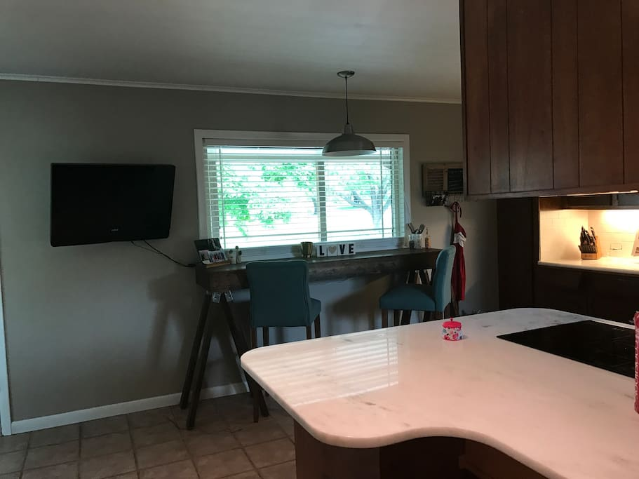 Kitchen with extra TV.