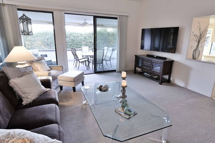 The living room opens up to the patio, creating a beautiful and free flowing space for entertaining guests.