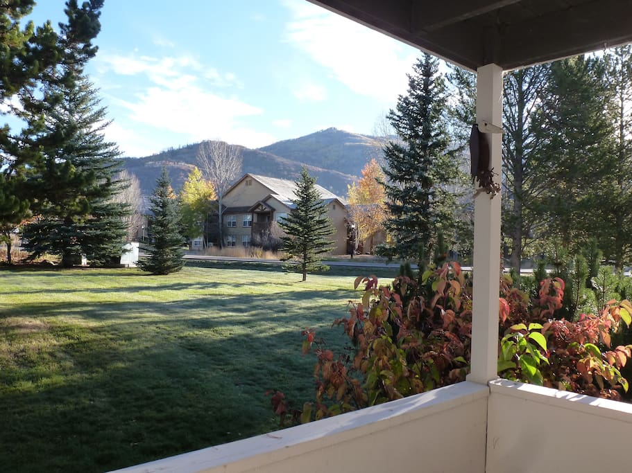 same view from the porch, along with a table and 2 chairs