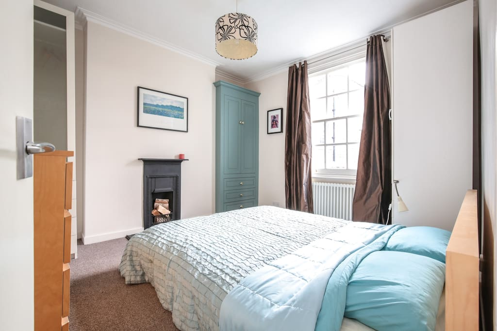Large double bedroom with view out over garden at rear.