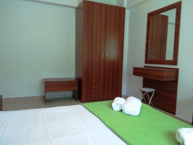 Room 2: Eastern orientation, bright mornings, cool afternoons. Double wardrobe, dressing table. Access to backside balcony for laundry.