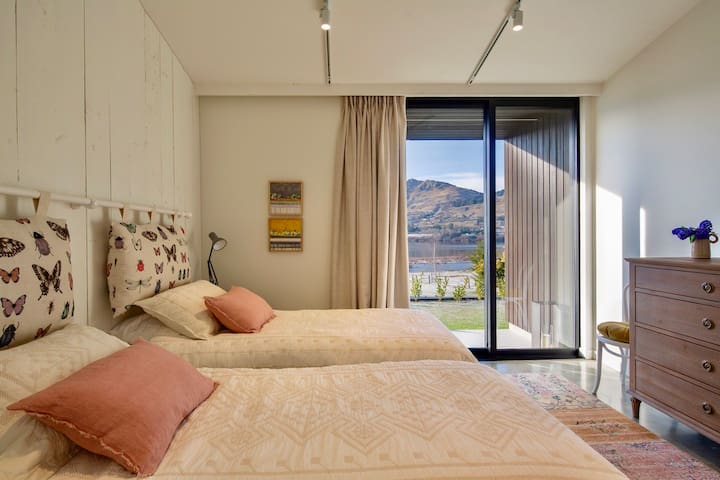 Both bedrooms have ample storage with chest of drawers, wardrobe, bedside tables and lamps.