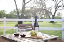 Enjoy a glass of local wine as you watch the sun set over the vineyards and walnut orchard