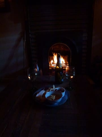 Snuggle in front of the fire as it gets cooler - we know photo is a little dark but trying to show you the atmosphere you'll have when you are the one in front of the fire!!