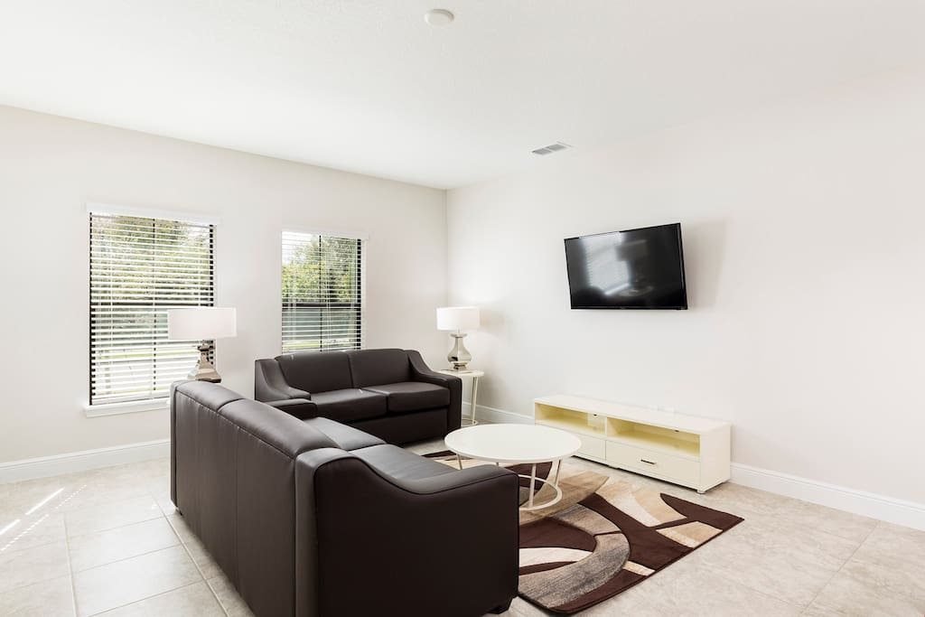 Relax in the cozy living room and catch a movie on the flatscreen TV.