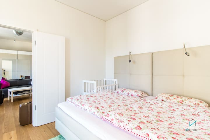 Next to the living room is this beautiful bedroom ready for your arrival.
