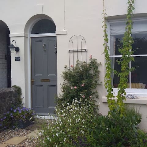 Front door and garden, with two hop bines to prove that you're in Kent!