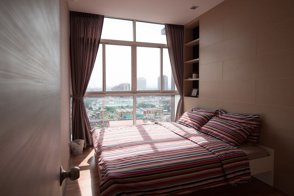 This is the smaller of the 2 bedrooms. As you can see, the window is huge with a nice view. You also get your own separate clothes closet which is on the right of the photo.